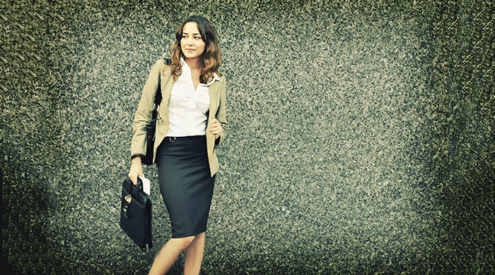 Professional woman in skirt and blazer