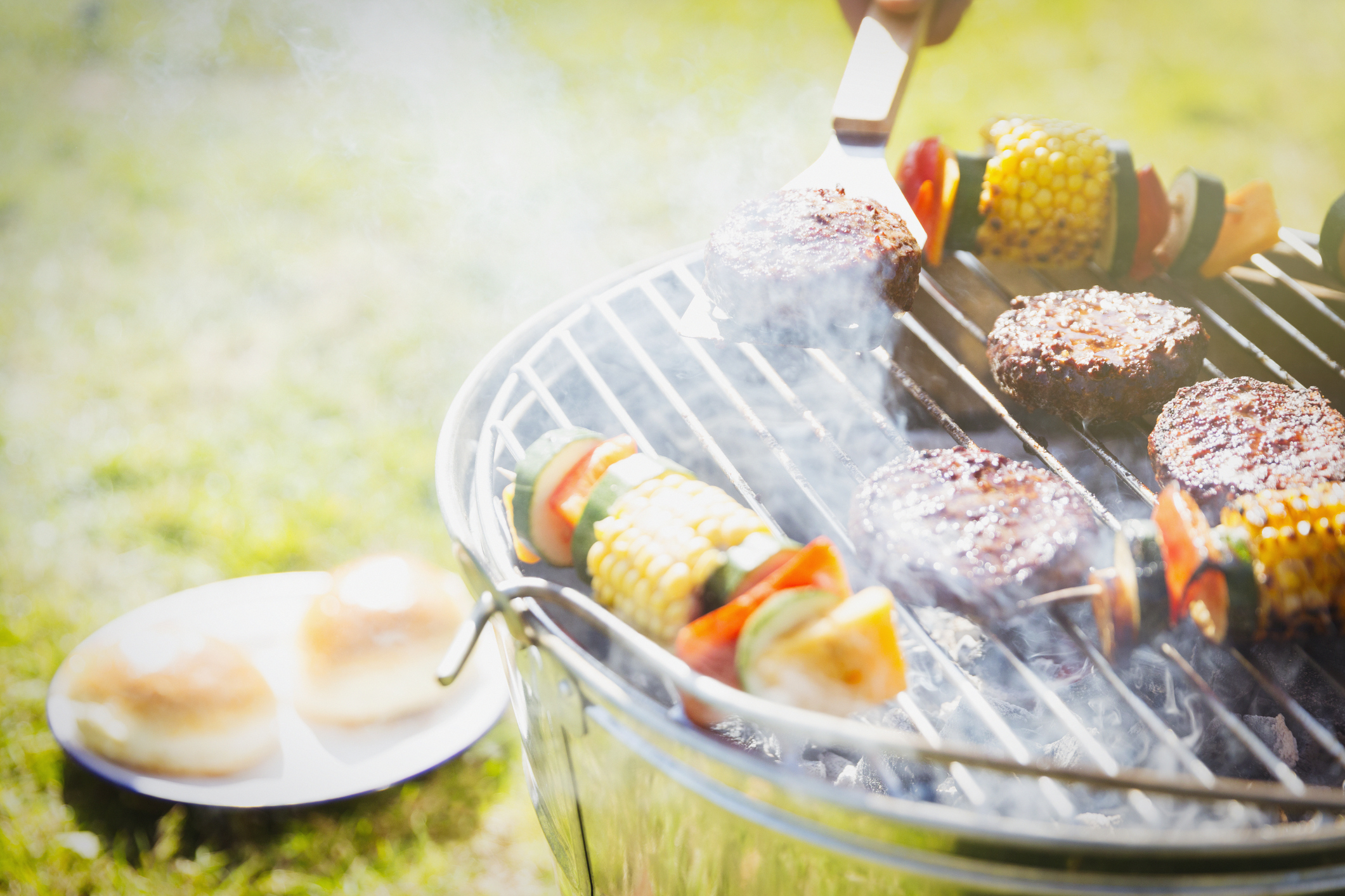Burgers and kabobs on a barbecue grill