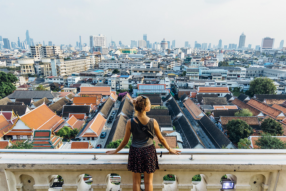 Woman overlooking a city